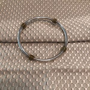 sterling silver bangle bracelet with gold accents